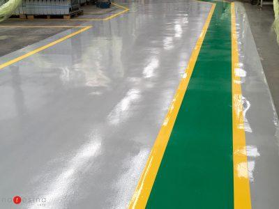 Pavimento industriale in resina con segnaletica per l'azienda Faber